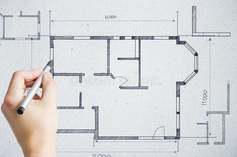 Real estate and project concept. Hand drawing creative building plan on concrete wall background. Real estate and project concept. Double exposure royalty free stock image