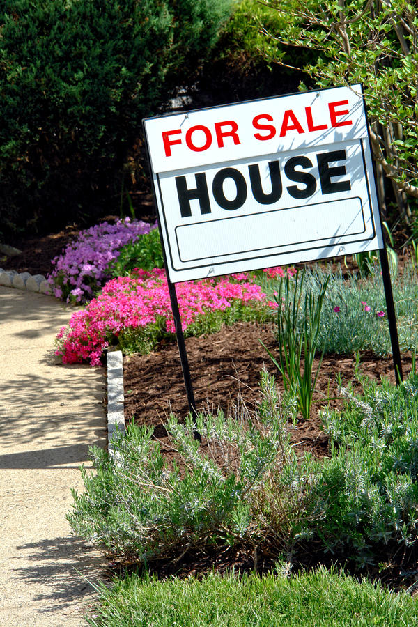 Real Estate For Sale Sign and House stock photo