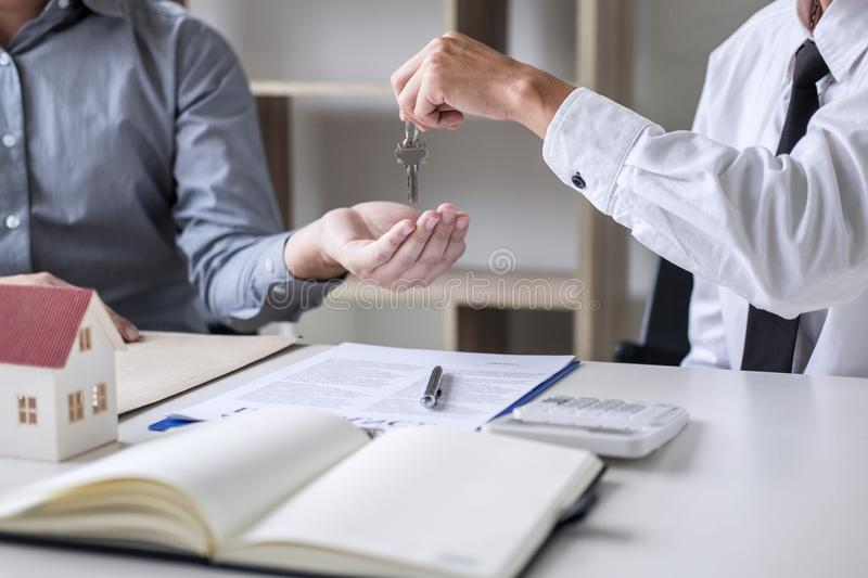 Real estate Sales manager giving keys to customer after signing rental lease contract of sale purchase agreement, concerning. Mortgage loan offer for and house stock photography
