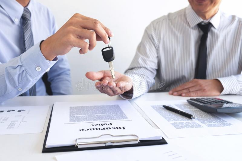 Real estate Sales manager giving keys to customer after signing rental lease contract of sale purchase agreement, concerning. Mortgage loan offer for and house stock photo
