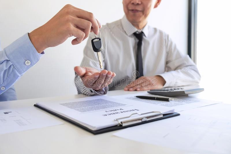 Real estate Sales manager giving keys to customer after signing rental lease contract of sale purchase agreement, concerning. Mortgage loan offer for and house royalty free stock photos