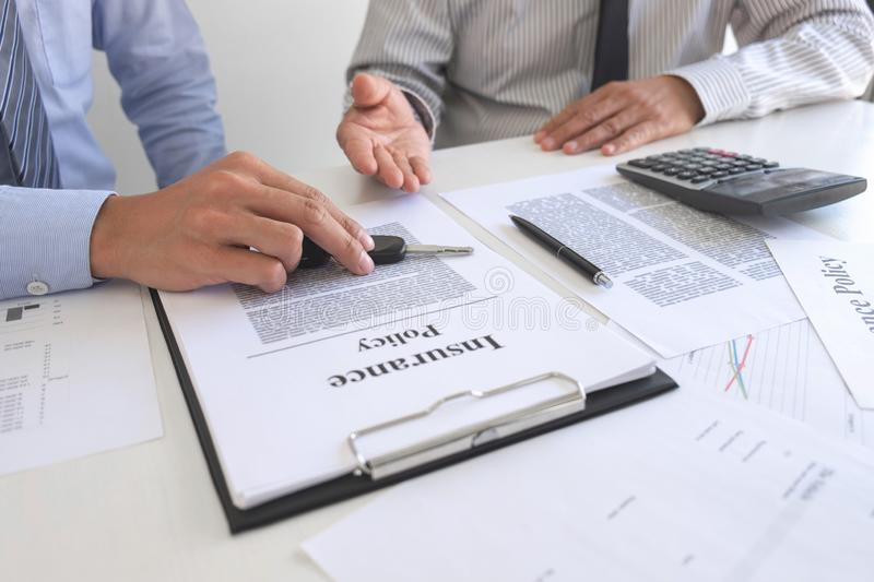 Real estate Sales manager giving keys to customer after signing rental lease contract of sale purchase agreement, concerning. Mortgage loan offer for and house stock image