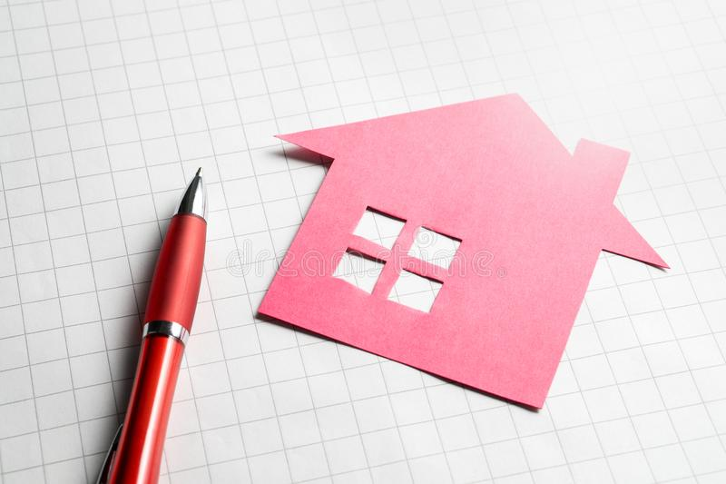 Real estate and selling or buying homes concept. Apartment for sale. Pen, paper and cardboard paper house royalty free stock images