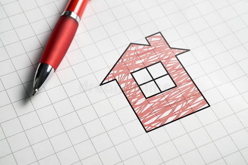 Real estate and selling or buying homes concept. Apartment for sale. Pen, paper and drawing of house royalty free stock photography
