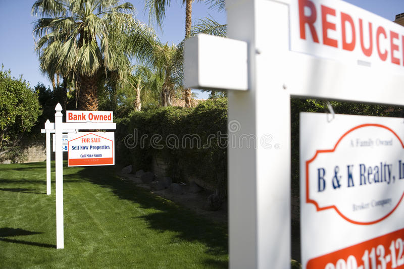 Real Estate Signs at Foreclosed Property stock photo