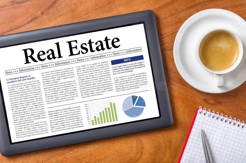 Real Estate. Tablet on a desk - Real Estate