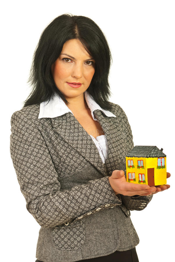 Real estate woman holding home. In her palms isolated on white background stock photos