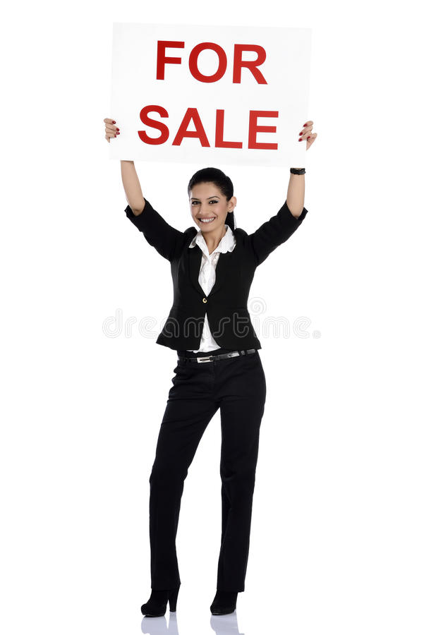 Real estate woman holding for sale sign stock photo