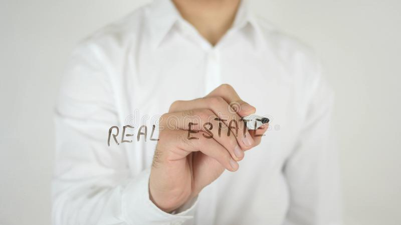 Real Estate, Written on Glass. High quality royalty free stock photo