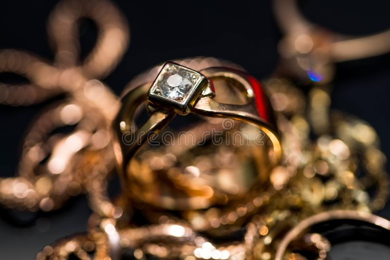 Real gold ring with diamonds, gems close up macro shot royalty free stock photography