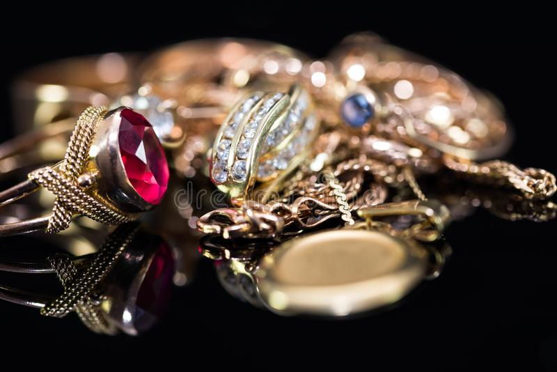 Real gold rings with diamonds, gem, neckless close up macro shot royalty free stock images