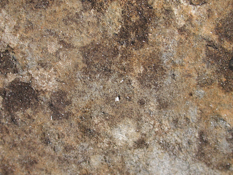 Real Grunge Rock Stone Texture. An earthy brown & gray stone with a dirty grunge surface useful as a background,layer or texture royalty free stock image