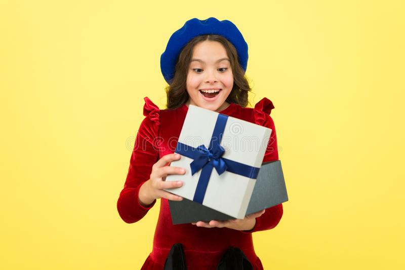 Real happiness. school fall season. surprised small girl with present box. small girl hold holiday gift. happy birthday. Boxing day. parisian girl in french stock image