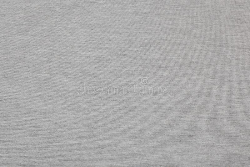 Real heather grey knitted fabric made of synthetic fibres textured background stock image