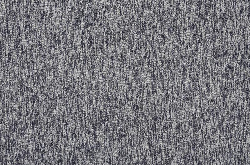 Real heather knitted fabric made of synthetic fibres textured background. Colored fabric texture. Background with delicate stripe royalty free stock photography