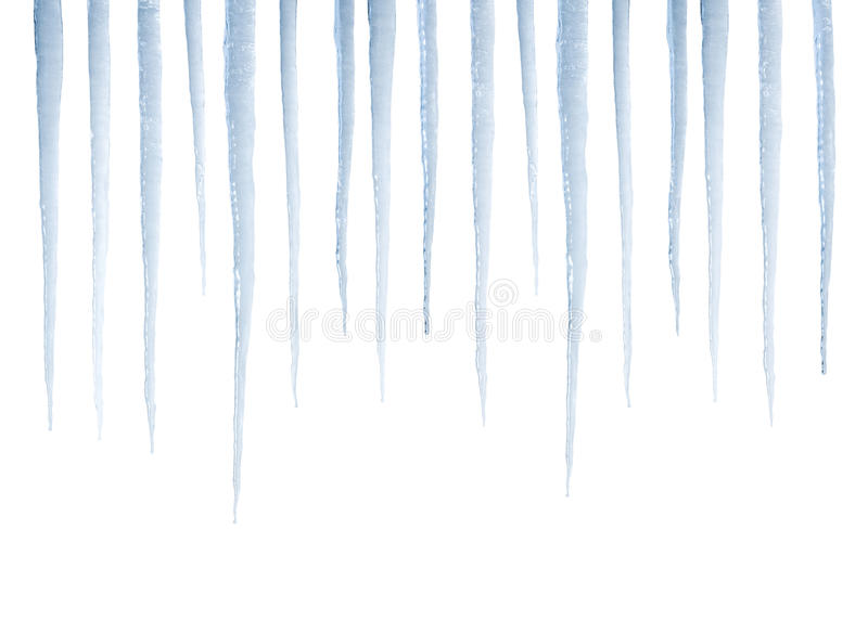 Real icicles isolated on white stock images