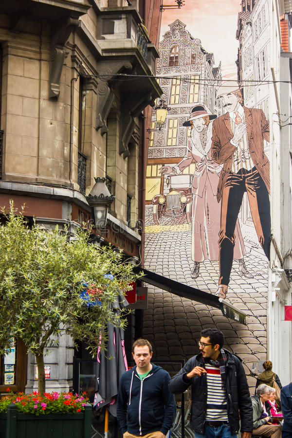 Real life and comics together in Brussels streets royalty free stock image