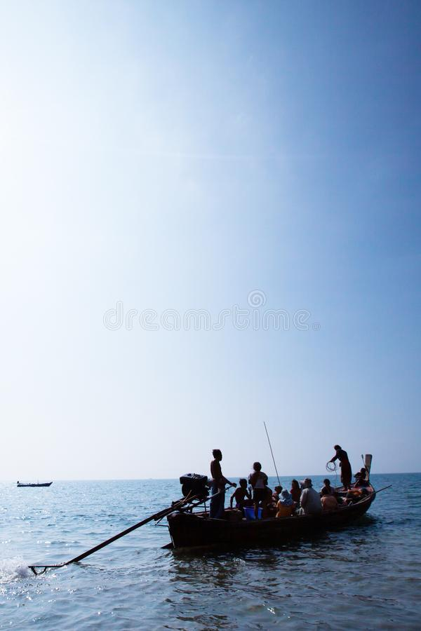Real life, a Moken family on old traditional boat in the andaman sea, Thailand-Myanmar border. Sea gypsy stock photography