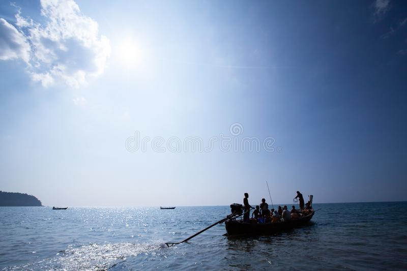Real life, a Moken family on old traditional boat in the andaman sea, Thailand-Myanmar border. Sea gypsy. Moken live a semi-nomadic hunter-gatherer lifestyle stock images
