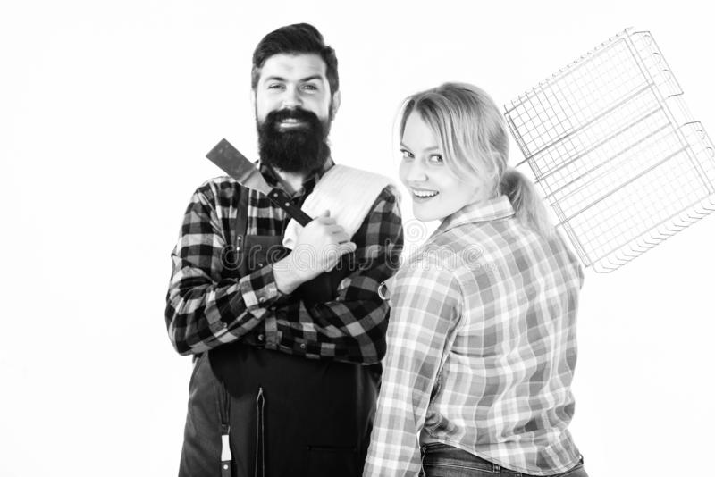 Real love. Tools for roasting meat. Couple in love hold kitchen utensils. Family weekend. Man bearded hipster and girl royalty free stock images