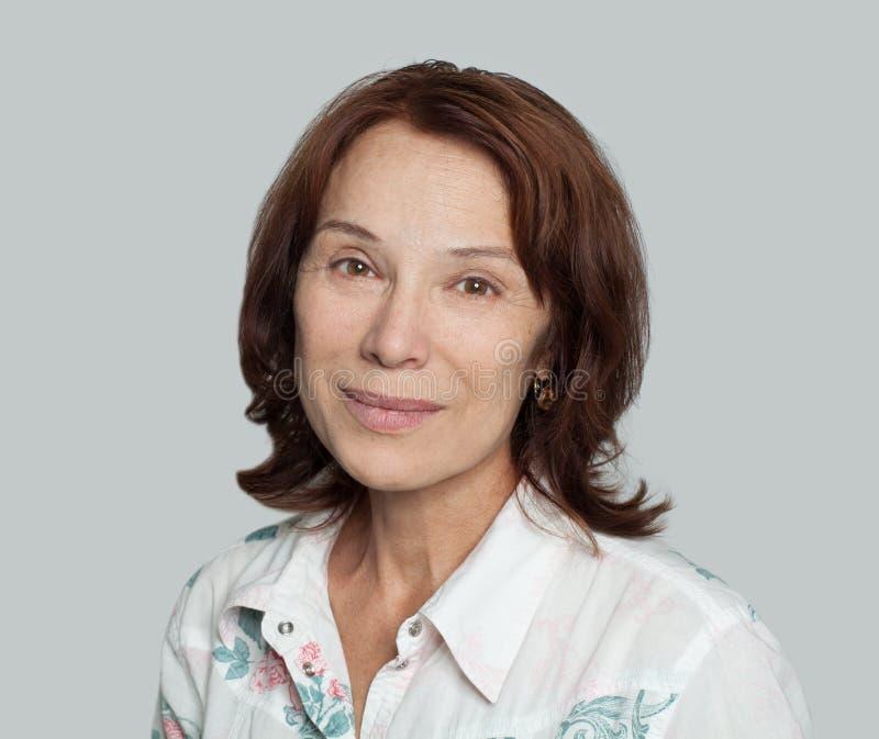 Real mature woman portrait. Happy mature lady portrait stock images