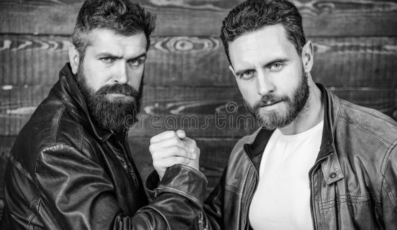 Real men and brotherhood. Strong handshake. Friendship of brutal guys. Mafia dealer. Real friendship of mature friends royalty free stock image