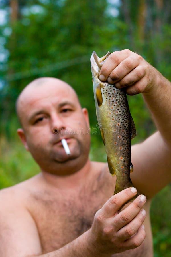 Real men go fishing stock image