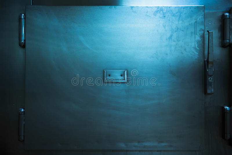 Real morgue trays in a low key photo stock images