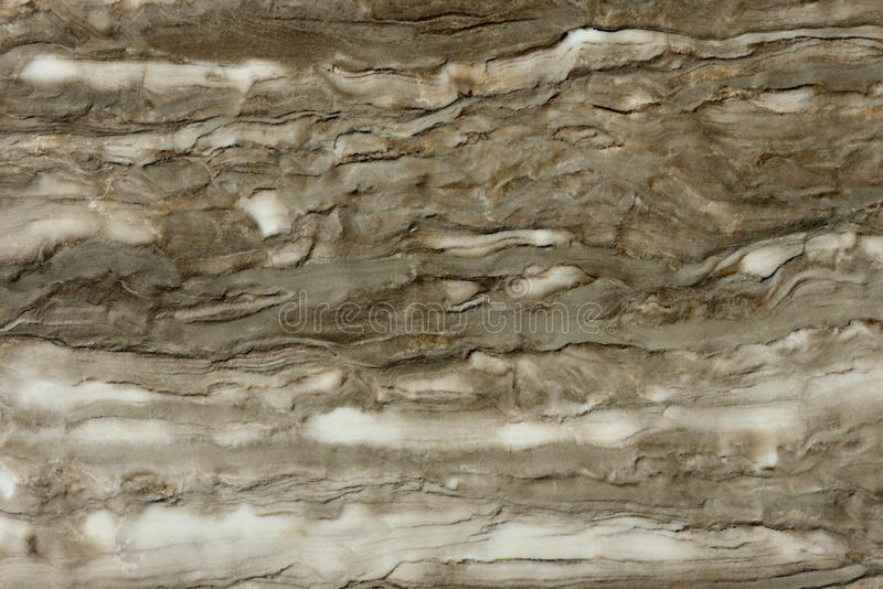 Real natural  pattern of marble Delicate Brown texture background. Natural pattern of marble brown color polished slice mineral. Super high resolution Delicate royalty free stock photography