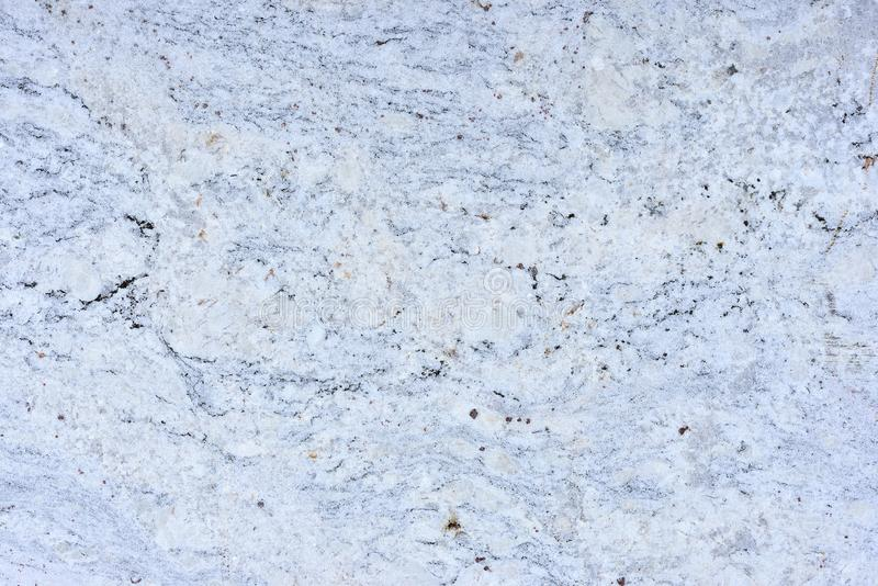 Real natural GRANITE Snow White pattern. Background stock photography
