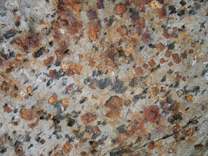 Real Natural Stone Textures 2. A rich stone texture featuring colorful blues, grays, rusty reds, browns and gray. Useful as a background,layer or texture royalty free stock photo