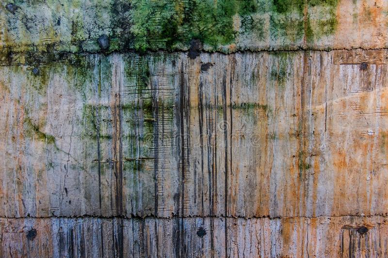 The real old grunge wall, dirty with brown rust, green moss and royalty free stock photos