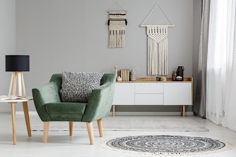 Simple, white and gray living room interior with a sofa between royalty free stock image