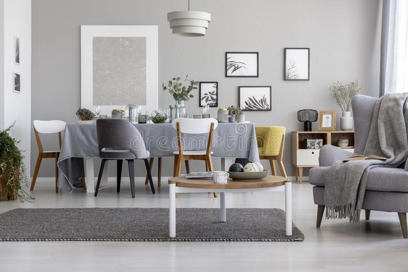 Real photo of light grey living room interior royalty free stock image
