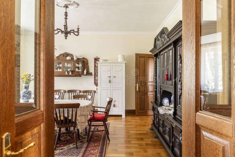 Real photo of a spacious, wooden dining room interior with a set royalty free stock images