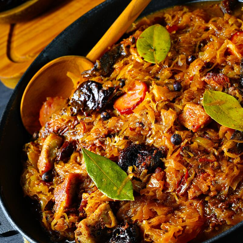 Real Polish `Bigos,`after an old recipe with dried plums and wine. A real Polish `Bigos,`after an old recipe with dried plums and wine royalty free stock photography