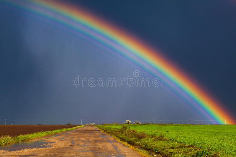 Real rainbow. Beautiful real rainbow and dirt road