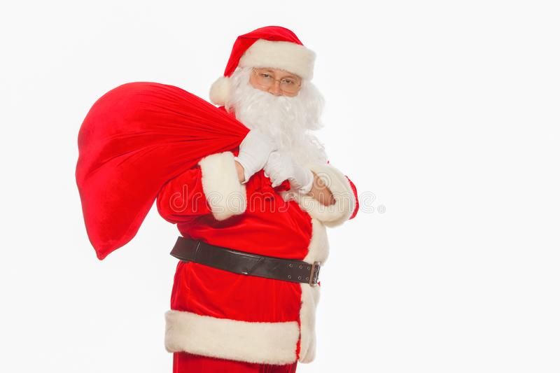 real Santa Claus carrying big bag and showing ok, isolated on white background Christmas royalty free stock photos