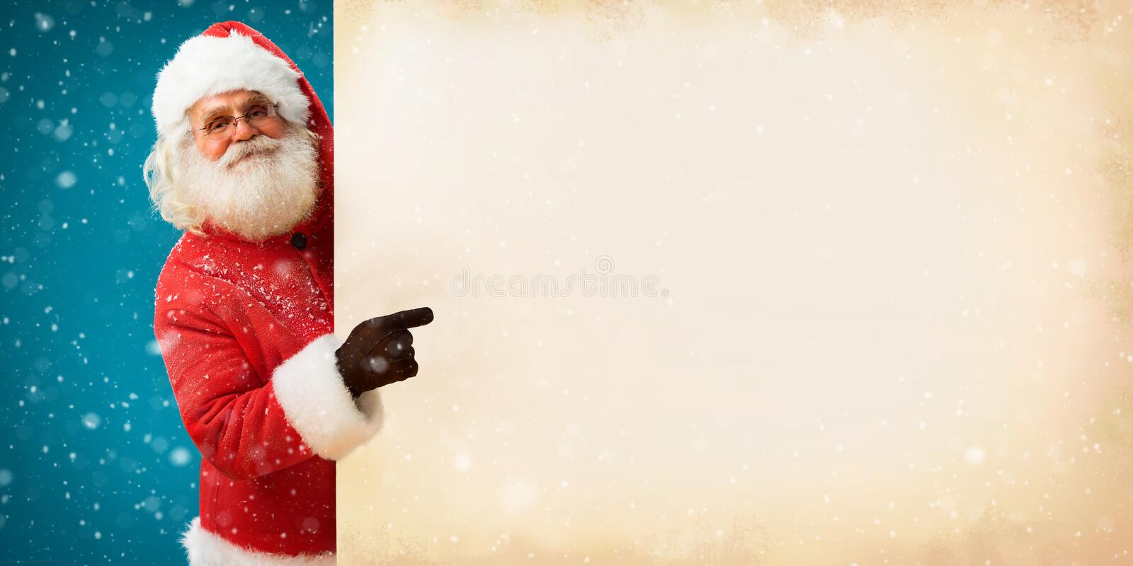 Real Santa Claus holding white blank sign for your text stock image