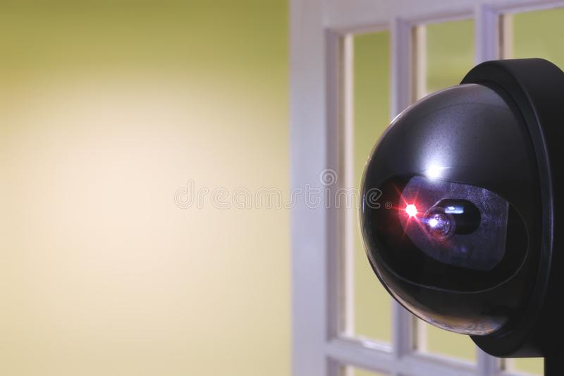 Real security camera inside of the office building or home room, in front of the door. CCTV camera or surveillance system install stock photography