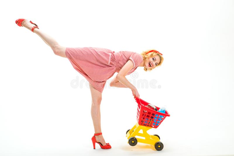 Real shopaholic. happy retro woman go shopping. I have done it. Having fun. shop assistant or store worker with shopping royalty free stock photo