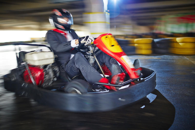 Real speed for a real man. Businessman enjoying kart racing alone stock images