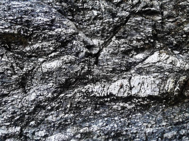 Real stone texture background. gray. Waterfall. Rock surface. gr. Ey stone wall royalty free stock photography