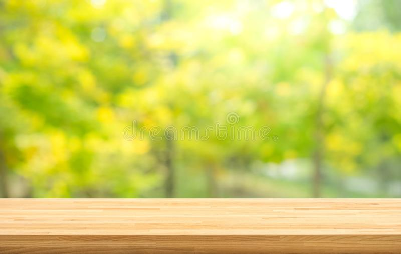 Real wood table top texture on leaf tree garden background.For create product display or design key visual. Layout stock image