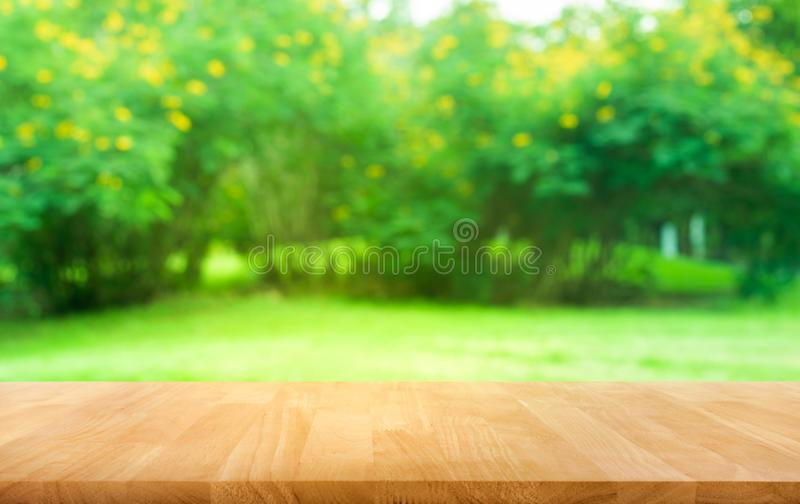 Real wood table top texture on leaf tree garden background. For create product display or design key visual royalty free stock photography