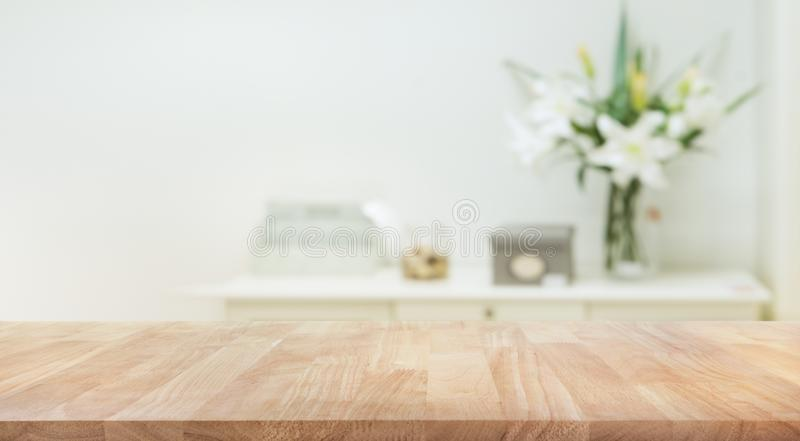Real wood table top texture on white wall room background. royalty free stock photo