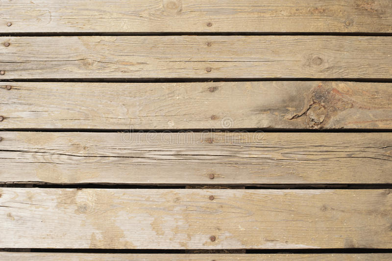 Real wooden floor put together with nails. The way we touch nature easily. Old wood background, texture stock photography