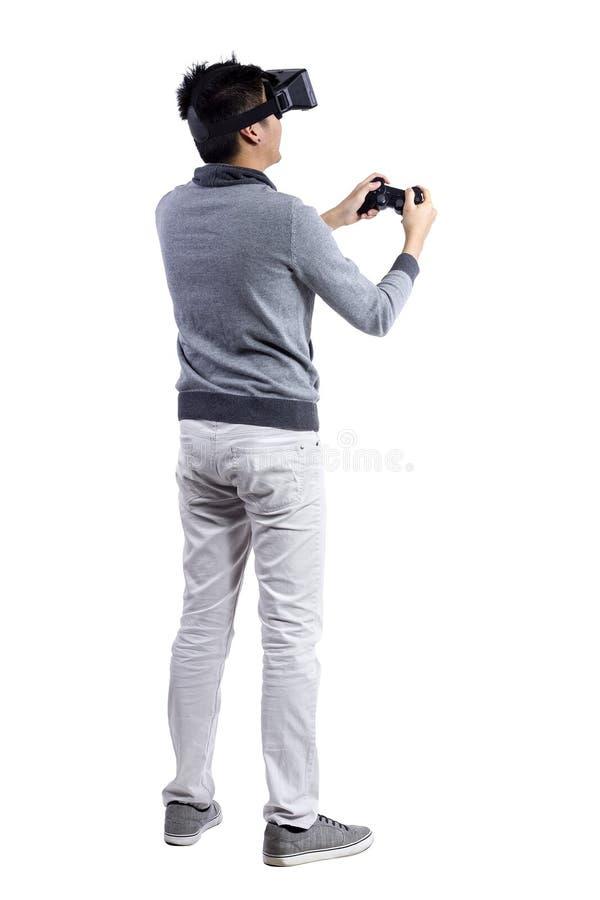 Realidad virtual con el regulador del juego foto de archivo