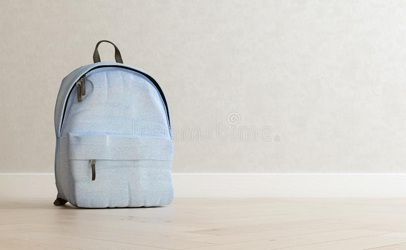 Realistic baby blue backpack on the wooden floor and light beige wall in the background, close up, mock-up, poster royalty free stock images