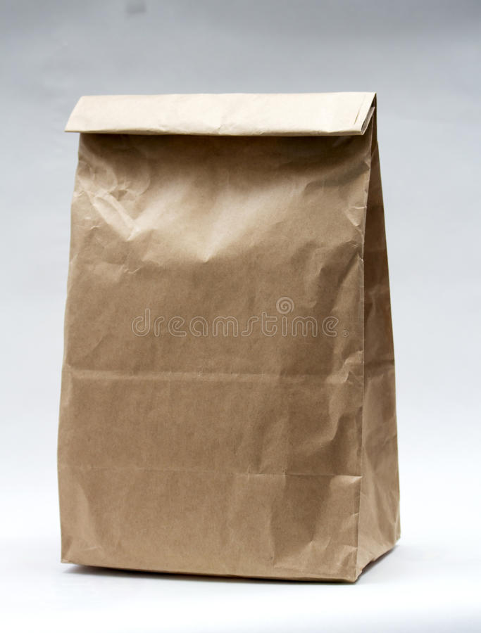 Realistic brown paper bag on white background royalty free stock photo